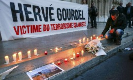 People pay tribute to Gourdel a French mountain guide who was beheaded by an Algerian Islamist group, in Lyon